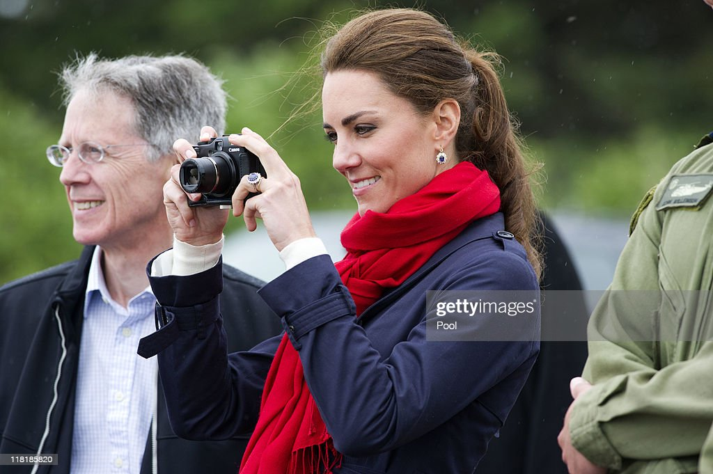 Catherine, Duchess of Cambridge takes photographs as Prince William, Duke of Cambridge takes part in helicopter manouvres called 'water birding' across Dalvay lake on July 4, 2011 in Charlottetown, Canada. The newly married Royal Couple are on the fifth day of their first joint overseas tour. The 12 day visit to North America is taking in some of the more remote areas of the country such as Prince Edward Island, Yellowknife and Calgary. The Royal couple started off their tour by joining millions of Canadians in taking part in Canada Day celebrations which mark Canada's 144th Birthday.