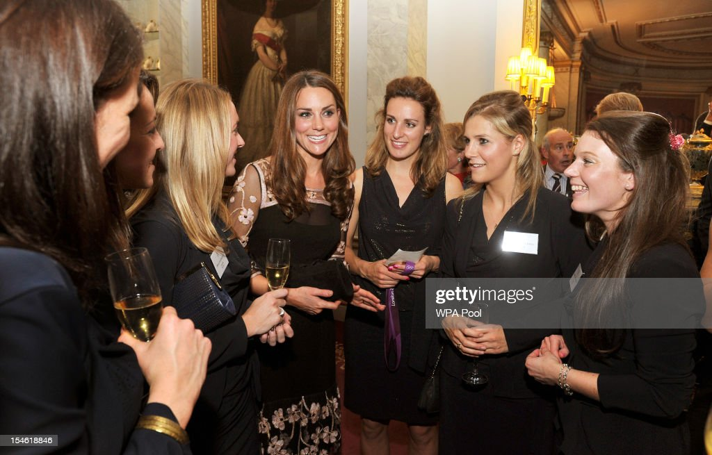 <a gi-track='captionPersonalityLinkClicked' href=/galleries/search?phrase=Catherine+-+Duchess+of+Cambridge&family=editorial&specificpeople=542588 ng-click='$event.stopPropagation()'>Catherine</a>, Duchess of Cambridge (C) talks the Women's hockey team during a reception held for Team GB Olympic and Paralympic London 2012 medalists at Buckingham Palace on October 23, 2012 in London, England.