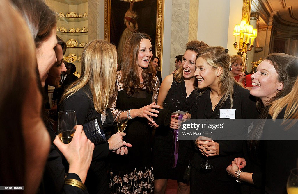 Catherine, Duchess of Cambridge (C) talks the Women's hockey team during a reception held for Team GB Olympic and Paralympic London 2012 medalists at Buckingham Palace on October 23, 2012 in London, England.