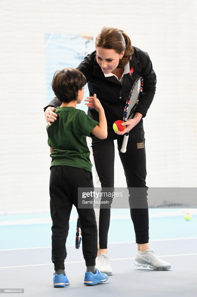 Catherine, Duchess of Cambridge talks to a child as she visits the Lawn Tennis Association at National Tennis Centre on October 31, 2017 in London, England. The Duchess of Cambridge became Patron of the LTA in December 2016.