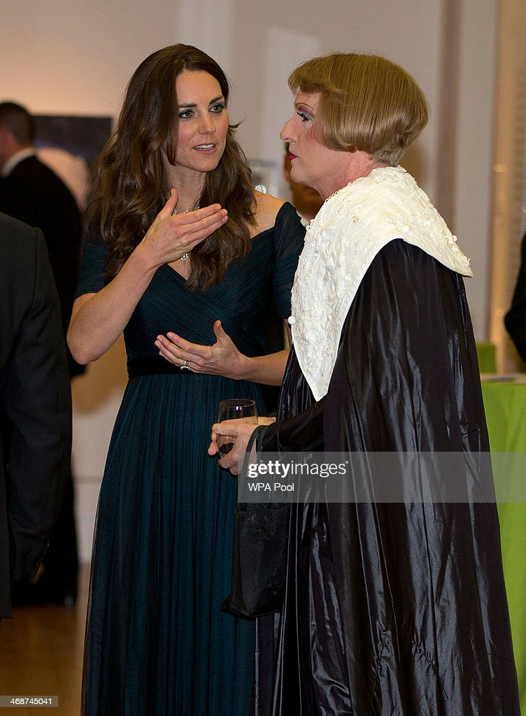 Catherine, Duchess of Cambridge talks to British artist Grayson Perry as they attend The Portrait Gala 2014: Collecting To Inspire at National Portrait Gallery on February 11, 2014 in London, England. The Duchess is wearing a dress by British designer Jenny Packham and a necklace on loan from Queen Elizabeth II that was given to the Queen as a gift for her wedding in 1947.