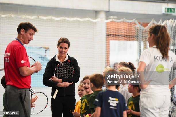 Catherine Duchess of Cambridge talks to children and tennis player Johanna Konta as she visits the Lawn Tennis Association at National Tennis Centre...