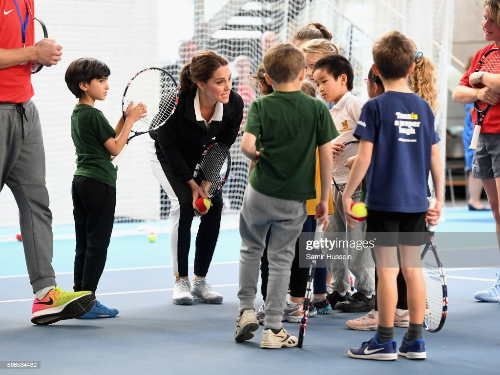 Catherine, Duchess of Cambridge talks to children as she visits the Lawn Tennis Association at National Tennis Centre on October 31, 2017 in London, England. The Duchess of Cambridge became Patron of the LTA in December 2016.