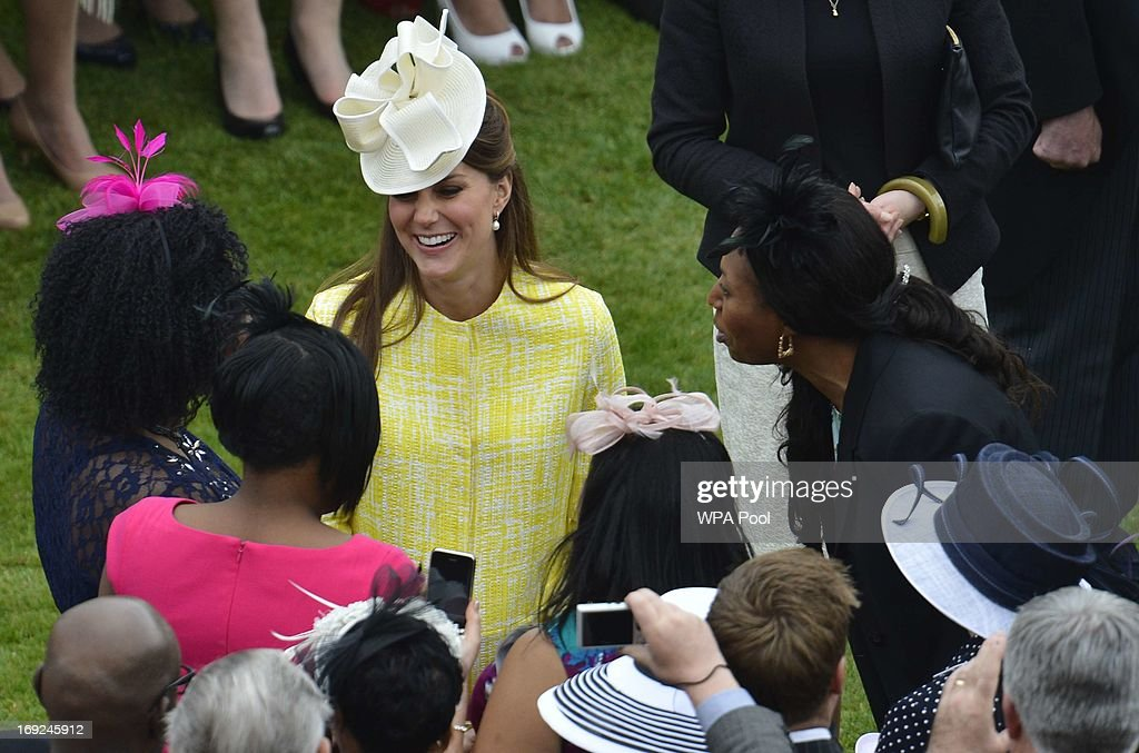<a gi-track='captionPersonalityLinkClicked' href=/galleries/search?phrase=Catherine+-+Duchesse+de+Cambridge&family=editorial&specificpeople=542588 ng-click='$event.stopPropagation()'>Catherine</a>, Duchess of Cambridge talks to guests as she attends a Garden Party in the grounds of Buckingham Palace hosted by Queen Elizabeth II on May 22, 2013.