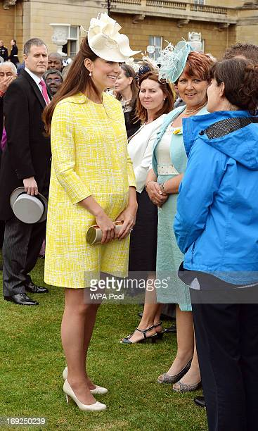 Catherine Duchess of Cambridge talks to guests as she attends a Garden Party in the grounds of Buckingham Palace hosted by Queen Elizabeth II on May...