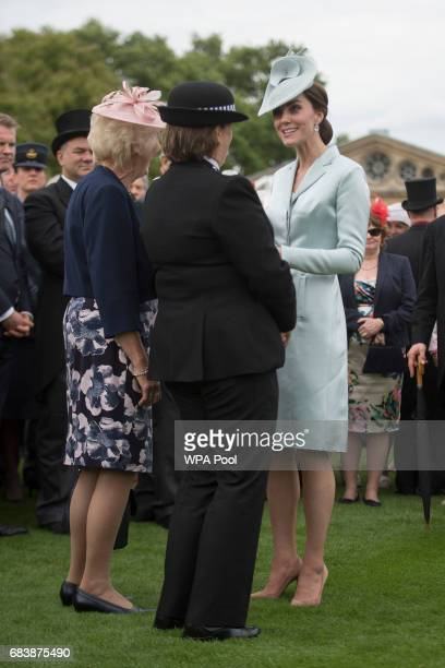 Catherine Duchess of Cambridge talks to guests during a garden party at Buckingham Palace on May 16 2017 in London England