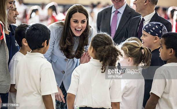 Catherine Duchess of Cambridge talks to local school children as she arrives to open the new Kensington Leisure Centre in Kensington on January 19...
