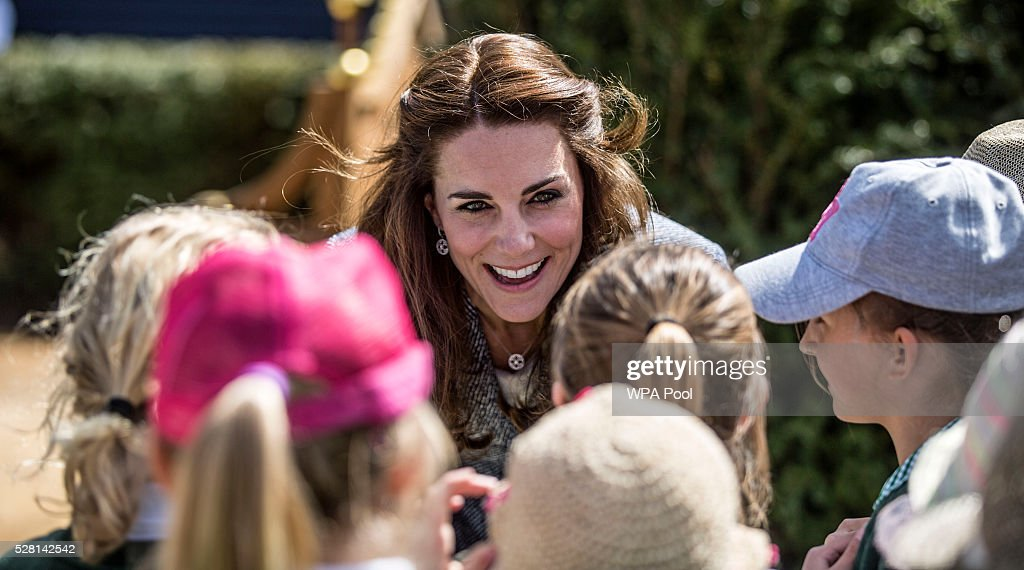 <a gi-track='captionPersonalityLinkClicked' href=/galleries/search?phrase=Catherine+-+Duchess+of+Cambridge&family=editorial&specificpeople=542588 ng-click='$event.stopPropagation()'>Catherine</a>, Duchess of Cambridge talks to local school children as she officially opens The Magic Garden at Hampton Court Palace on May 4, 2016 in London, England.
