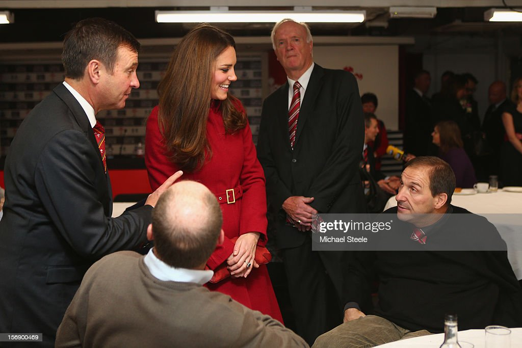 Catherine, Duchess of Cambridge talks to Paul Davies (R), a former player and beneficiary of the Charitable Trust which supports injured players in Wales, ahead of the Autumn International rugby match between Wales and New Zealand at the Millennium Stadium, Cardiff on November 24, 2012 in Cardiff, Wales.