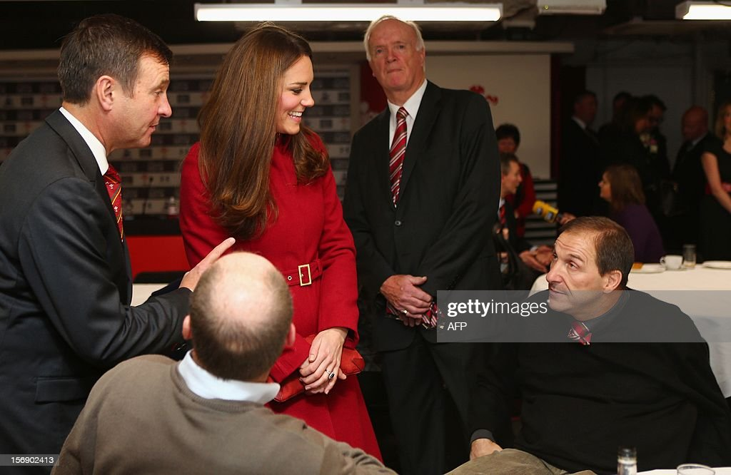 Catherine, Duchess of Cambridge talks to Paul Davies (R), a former player and beneficiary of the Charitable Trust which supports injured players in Wales, ahead of the Autumn International rugby match between Wales and New Zealand at the Millennium Stadium, Cardiff on November 24, 2012 in Cardiff, Wales. AFP PHOTO/POOL/ Michael Steele