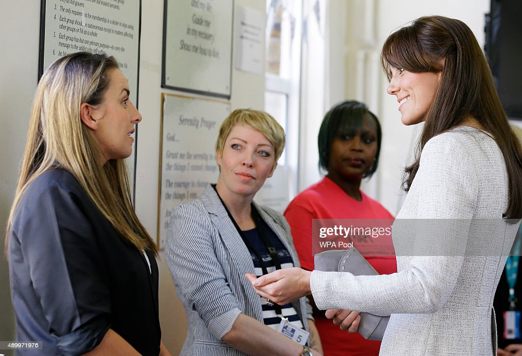 Catherine, Duchess of Cambridge talks to RAPt graduates Kirsty Tate (L) and Kirsty Lacey (2nd L) as well as Isha Walker (2nd R), who is currently on the RAPt Programme, during a visit to the Rehabilitation of Addicted Prisoners Trust at HMP Send on September 25, 2015 in Woking, United Kingdom.