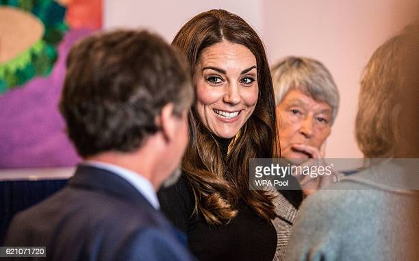 Catherine Duchess of Cambridge talks to staff members during a visit to the Nelson Trust Women's Centre on November 4 2016 in Gloucester England The...