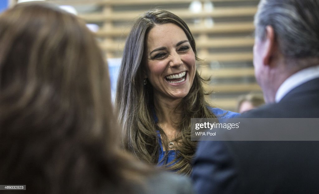 Catherine, Duchess of Cambridge talks to students and staff during the opening of the ICAP Art Room at Northolt High School on February 14, 2014 in Ealing, England. The Duchess of Cambridge has been Royal Patron of The Art Room since January 2012, reflecting her interest in the arts and her particular interest in using the creativity of art to enrich the lives of young people. The Art Room is a national charity which offers art as therapy to children and young people aged five to 16 who are facing challenges in their lives. Art Room practitioners support students and help them grow their self-confidence, self-esteem and engagement with education through art.