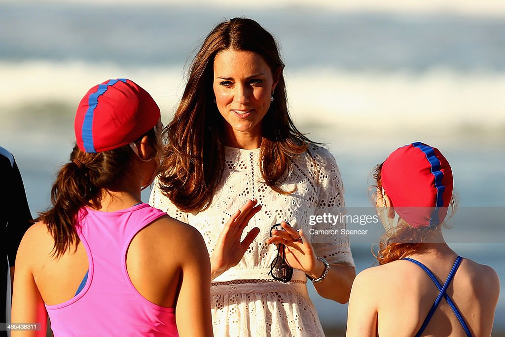 Catherine, Duchess of Cambridge talks to surf life-savers at Manly Beach during a surf life-saving presentation on April 18, 2014 in Sydney, Australia. The Duke and Duchess of Cambridge are on a three-week tour of Australia and New Zealand, the first official trip overseas with their son, Prince George of Cambridge.
