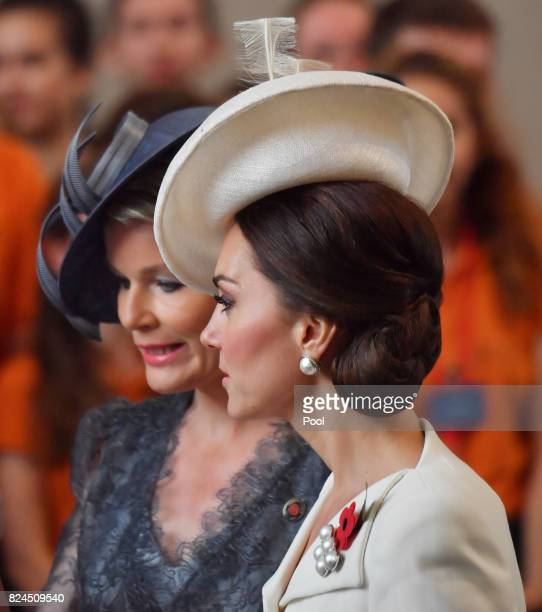 Catherine Duchess of Cambridge talks with Queen Mathilde of Belgium as they attend commemorations marking the centenary of Passchendale in the town...