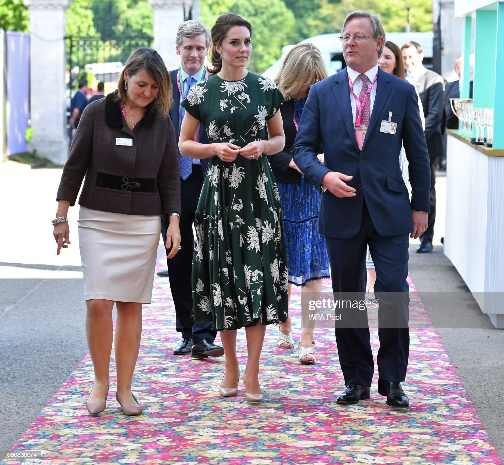 Catherine, Duchess of Cambridge (C), talks with Royal Horticultural Society (RHS) judge Mark Fane (R) as she arrives at the RHS Chelsea Flower Show press day at Royal Hospital Chelsea on May 22, 2017 in London, England. The prestigious Chelsea Flower Show, held annually since 1913 in the Royal Hospital Chelsea grounds, is open to the public from the 23rd to the 27th of May, 2017.