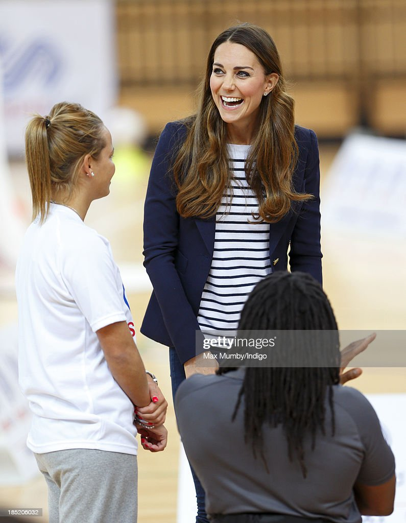 Catherine, Duchess of Cambridge talks with wheelchair basketball player Ade Adepitan as she attends a SportsAid Athlete Workshop in the Copper Box Arena at the Queen Elizabeth Olympic Park on October 18, 2013 in London, England.