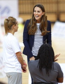 Catherine Duchess of Cambridge talks with wheelchair basketball player Ade Adepitan as she attends a SportsAid Athlete Workshop in the Copper Box...