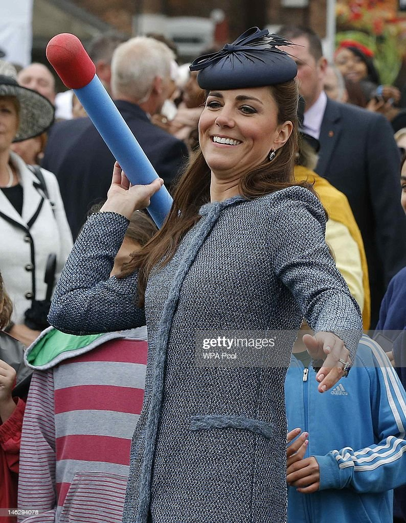 Catherine, Duchess of Cambridge throws a foam javelin as part of a children's sports event while visiting Vernon Park during a Diamond Jubilee visit to Nottingham on June 13, 2012 in Nottingham, England.