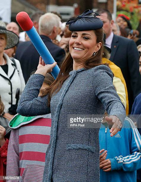 Catherine Duchess of Cambridge throws a foam javelin as part of a children's sports event while visiting Vernon Park during a Diamond Jubilee visit...