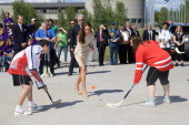 Catherine Duchess of Cambridge throws a hockey puck during an official welcome ceremony at the Somba K'e Civic Plaza on July 5 2011 in Yellowknife...
