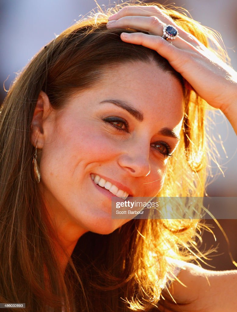 Catherine, Duchess of Cambridge touches her hair as she smiles after walking down Kuniya Walk at the base of Uluru on April 22, 2014 in Ayers Rock, Australia. The Duke and Duchess of Cambridge are on a three-week tour of Australia and New Zealand, the first official trip overseas with their son, Prince George of Cambridge.