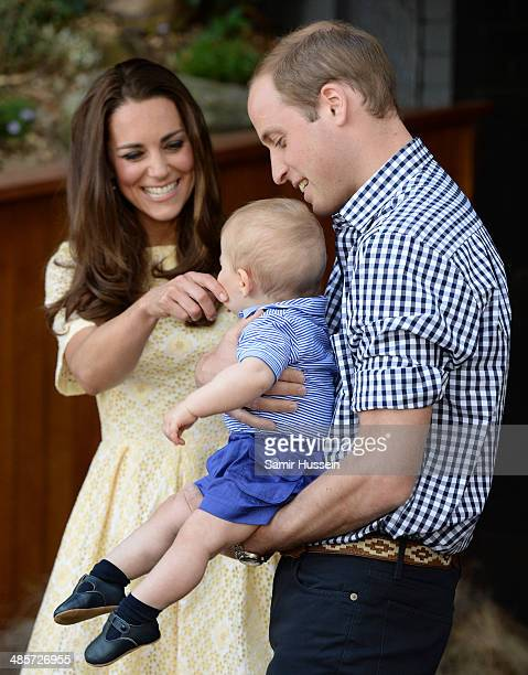 Catherine Duchess of Cambridge touches the face of Prince George of Cambridge as he is held by Prince William Duke of Cambridge during a visit to the...