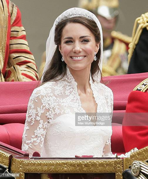 Catherine Duchess of Cambridge travels down The Mall on route to Buckingham Palace in a horse drawn carriage following her wedding at Westminster...