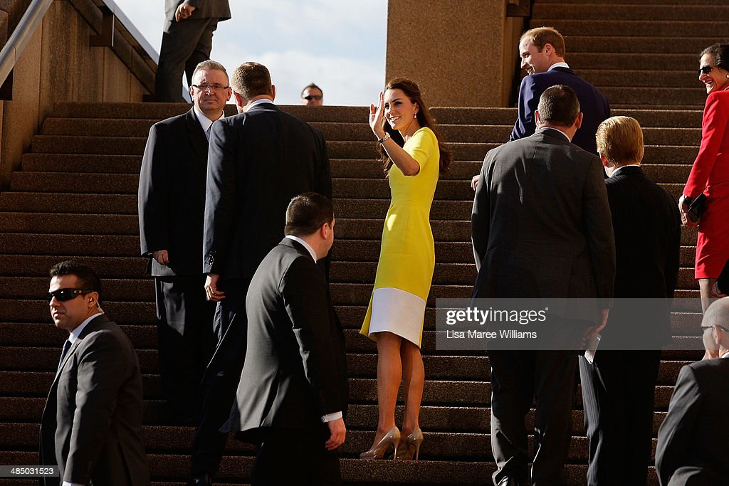 Catherine, Duchess of Cambridge turns to acknowledge the crowd as she walks the stairs of the Sydney Opera House with <a gi-track='captionPersonalityLinkClicked' href=/galleries/search?phrase=Prince+William&family=editorial&specificpeople=178205 ng-click='$event.stopPropagation()'>Prince William</a>, Duke of Cambridge on April 16, 2014 in Sydney, Australia. The Duke and Duchess of Cambridge are on a three-week tour of Australia and New Zealand, the first official trip overseas with their son, Prince George of Cambridge.