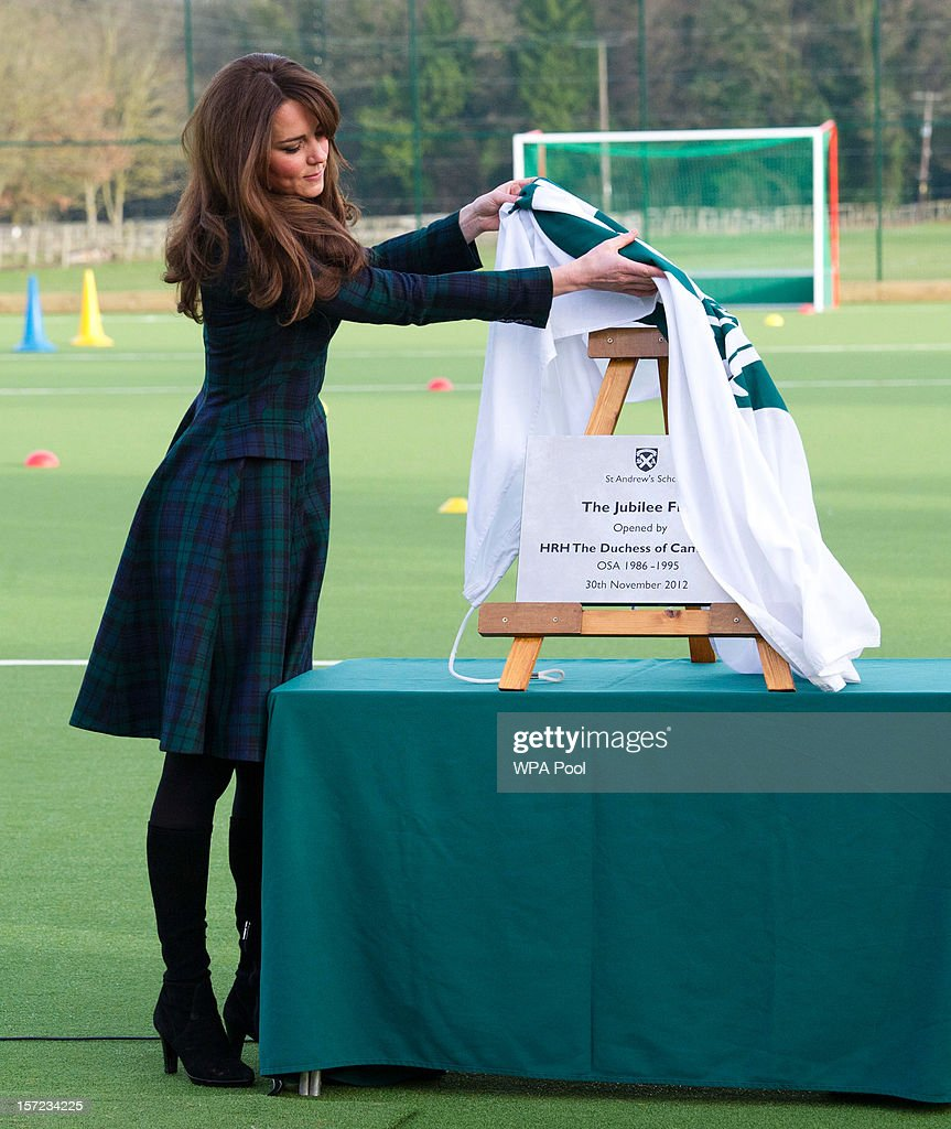 Catherine, Duchess of Cambridge unveils a plaque to officially open a new artificial turf playing field at St Andrew's School on November 30, 2012 in Pangbourne, Berkshire, England. The Duchess visited the Pre-Prep School for under-5s, met members of the school's hockey team, which she played for during her time as a pupil at the school (1986-1995), and took part in a day of activities and festivities to mark the occasion of St Andrew's Day. The Duchess also toured the school privately and watched the school's Progressive Games which are traditional games played indoors by teachers and students on St. Andrew's Day.
