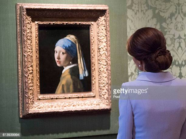 Catherine Duchess of Cambridge views the 'Girl with a Pearl Earring' by Johannes Vermeer as she visits the Mauritshuis Gallery during a solo visit to...