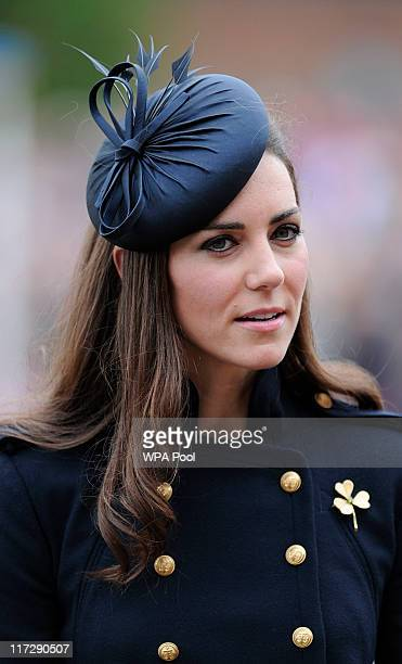Catherine Duchess of Cambridge visits Victoria Barracks during a medal parade for the 1st Battalion Irish Guards Regiment on June 25 in Windsor...