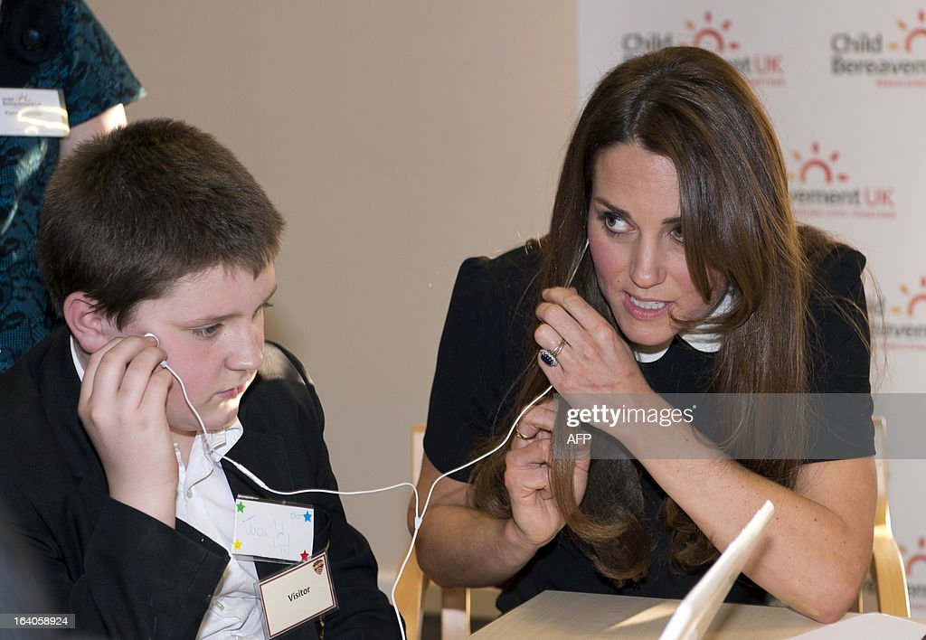 Catherine, Duchess of Cambridge, visits with her husband Prince William (unseen), Duke of Cambridge, the Child Bereavement, in Saunderton, Buckinghamshire, on March 19, 2013.