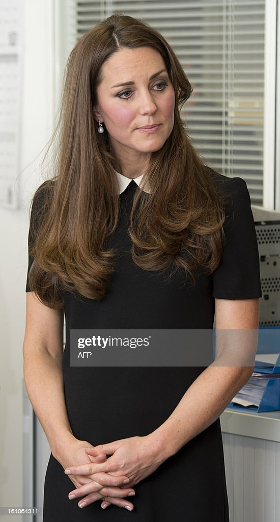 Catherine, Duchess of Cambridge, visits with her husband Prince William (unseen), Duke of Cambridge, the offices of Child Bereavement, in Saunderton, Buckinghamshire, on March 19, 2013.