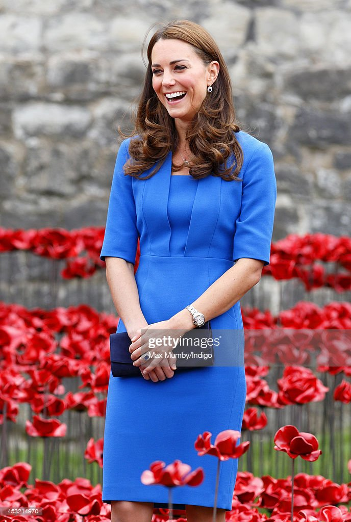 Catherine, Duchess of Cambridge walks through a poppy field art installation entitled 'Blood Swept Lands and Seas of Red' by artist Paul Cummins, in the moat of the Tower of London, to commemorate the First World War on August 5, 2014 in London, England. By it's completion on Armistice Day 2014 the moat will contain 888,246 ceramic poppies, one for each British and Colonial fatality during World War One.