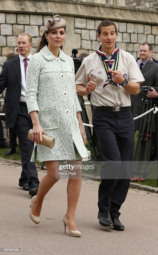 <a gi-track='captionPersonalityLinkClicked' href=/galleries/search?phrase=Catherine+-+Duchess+of+Cambridge&family=editorial&specificpeople=542588 ng-click='$event.stopPropagation()'>Catherine</a>, Duchess of Cambridge walks with Chief Scout <a gi-track='captionPersonalityLinkClicked' href=/galleries/search?phrase=Bear+Grylls&family=editorial&specificpeople=3061585 ng-click='$event.stopPropagation()'>Bear Grylls</a> (R) as she attends the National Review of Queen's Scouts at Windsor Castle on April 21, 2013.