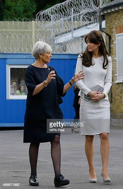 Catherine Duchess of Cambridge walks with trustee Benita Refson of RAPt during a visit to the Rehabilitation of Addicted Prisoners Trust at HMP Send...