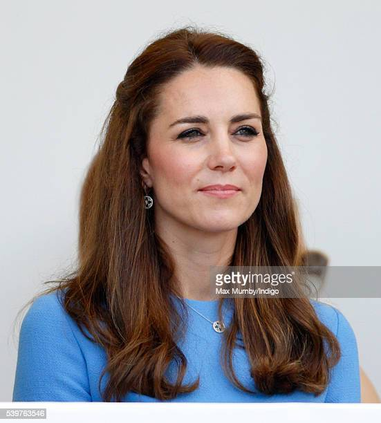 Catherine Duchess of Cambridge watches a carnival parade as she attends 'The Patron's Lunch' celebrations to mark Queen Elizabeth II's 90th birthday...