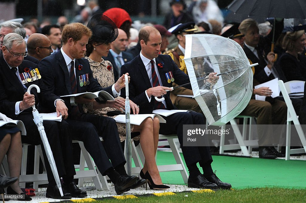 Catherine, Duchess of Cambridge watches as <a gi-track='captionPersonalityLinkClicked' href=/galleries/search?phrase=Prince+William&family=editorial&specificpeople=178205 ng-click='$event.stopPropagation()'>Prince William</a>, Duke of Cambridge puts up an umbrella during the Commemoration of the Centenary of the Battle of the Somme at the Commonwealth War Graves Commission Thiepval Memorial on July 1, 2016 in Thiepval, France. The event is part of the Commemoration of the Centenary of the Battle of the Somme at the Commonwealth War Graves Commission Thiepval Memorial in Thiepval, France, where 70,000 British and Commonwealth soldiers with no known grave are commemorated.