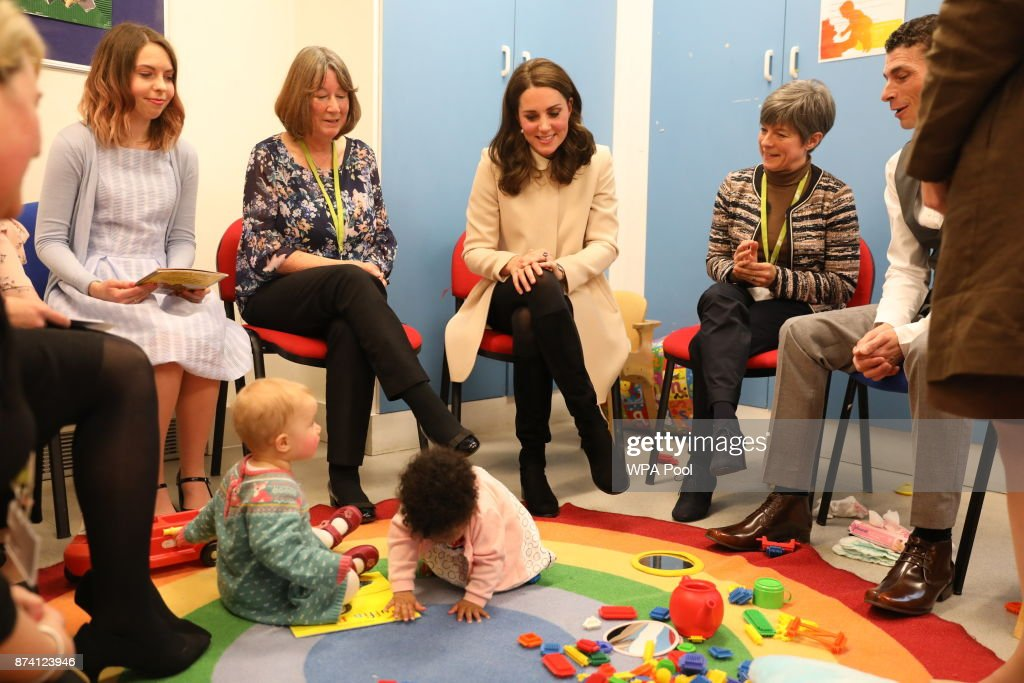 Catherine, Duchess of Cambridge watches children play in the nursery with mothers and staff as she visits the Hornsey Road Children's Centre on November 14, 2017 in Hornsey, London, England.