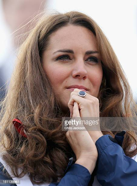 Catherine Duchess of Cambridge watches Great Britain Mixed Coxed Four Rowing LTAMix4 team celebrate after winning gold on day 4 of the London 2012...