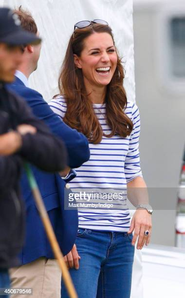 Catherine Duchess of Cambridge watches Prince William Duke of Cambridge Prince Harry play in the Jerudong Trophy charity polo match at Cirencester...