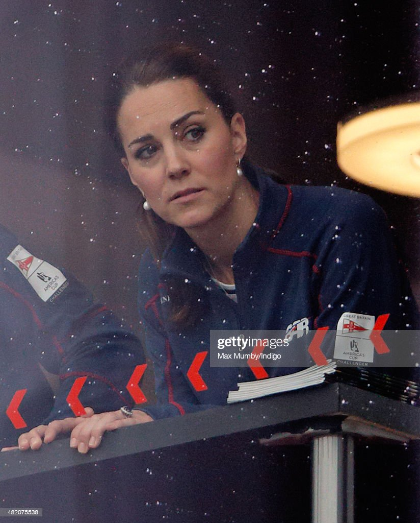 Catherine, Duchess of Cambridge watches the Land Rover BAR AC45 catamaran being craned out of the water during a visit to the Ben Ainslie Racing (Land Rover BAR) team base as she attends the America's Cup World Series event on July 26, 2015 in Portsmouth, England.