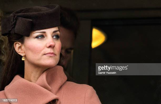 Catherine Duchess of Cambridge watches the races on day 4 of the Cheltenham Festival on Gold Cup Day at Cheltenham racecourse on March 15 2013 in...