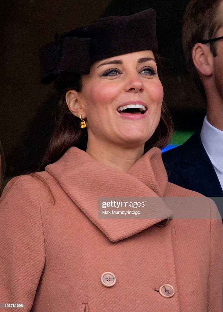 Catherine, Duchess of Cambridge watches the racing as she attends Day 4 of The Cheltenham Festival at Cheltenham Racecourse on March 15, 2013 in London, England.