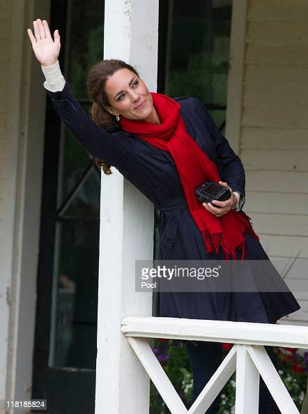 Catherine Duchess of Cambridge wave as Prince William Duke of Cambridge takes part in helicopter manouvres called 'water birding' across Dalvay lake...