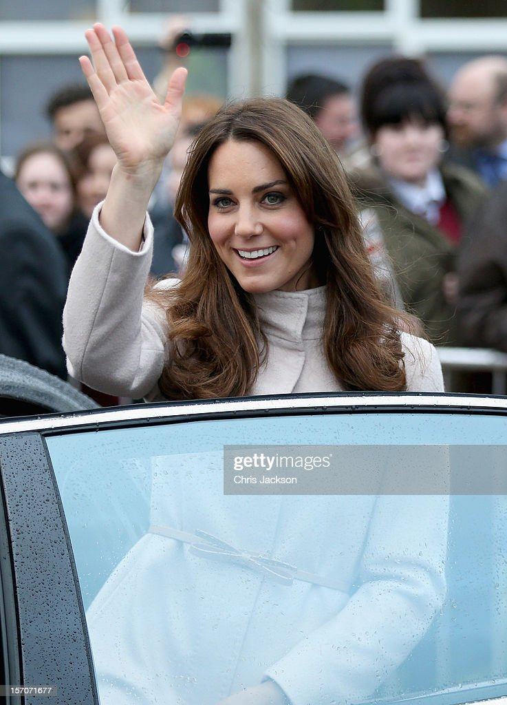 Catherine, Duchess of Cambridge waves as she leaves Manor School as she pays an official visit to Cambridge with Prince William, Duke of Cambridge on November 28, 2012 in Cambridge, United Kingdom.