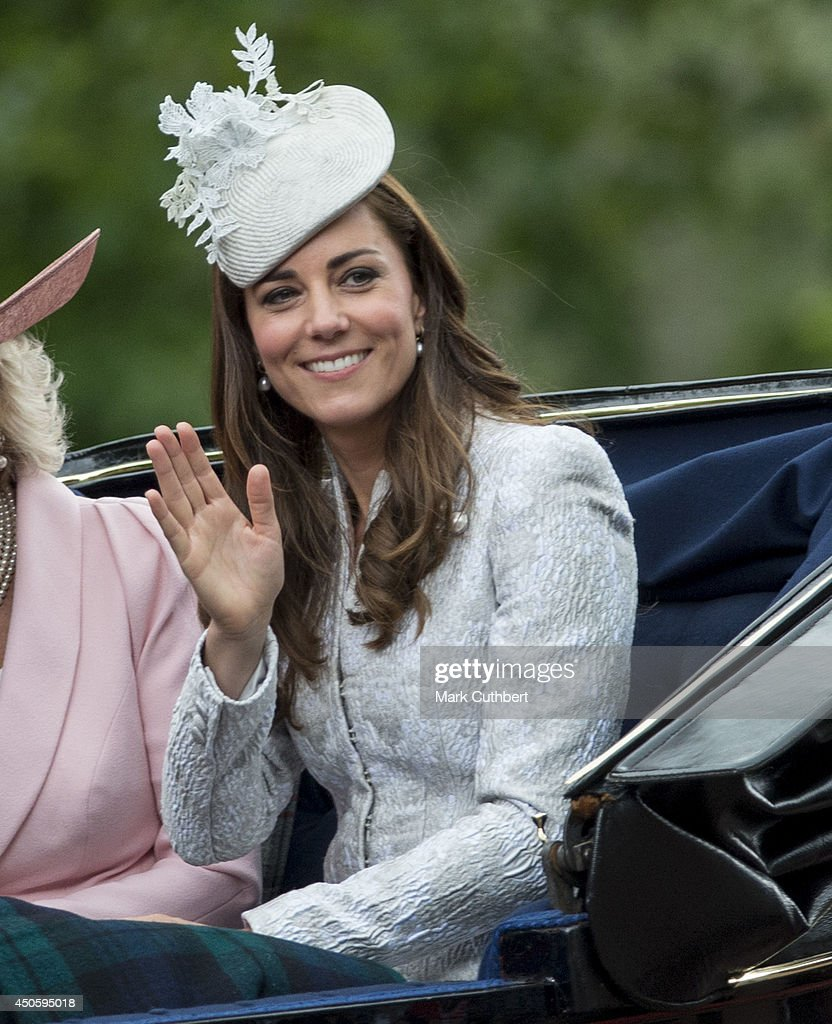 Catherine, Duchess of Cambridge waves during Trooping the Colour at The Royal Horseguards on June 14, 2014 in London, England.