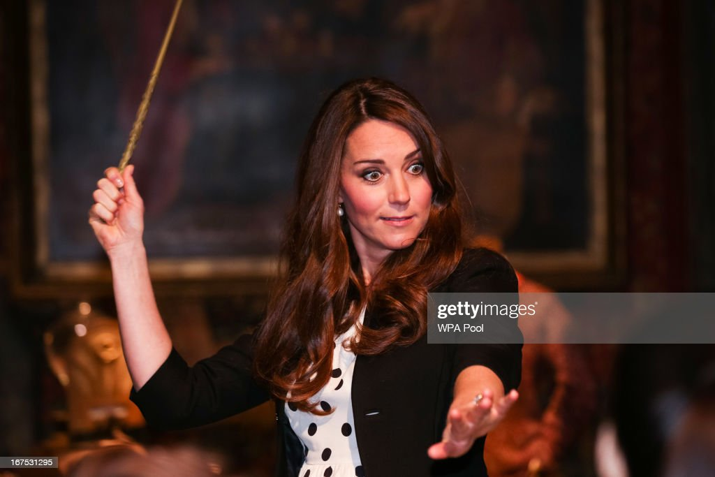 Catherine, Duchess of Cambridge waves her wand on the set used to depict Diagon Alley in the Harry Potter Films during the Inauguration Of Warner Bros. Studios Leavesden on April 26, 2013 in London, England.