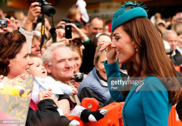 Catherine Duchess of Cambridge waves to a baby after attending a Palm Sunday service at St Paul's Anglican Cathedral on April 13 2014 in Dunedin New...